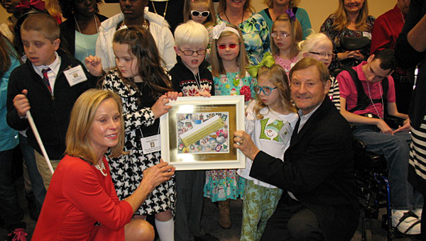 Creek View Elementary School student Carter Richardson, top left, was among those honored during the Bachus family's Christmas card call for art at the Hoover Public Library on Dec. 5. (Contributed)