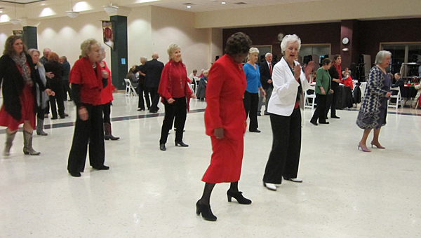 Members of the Alabaster Senior Center get into the holiday spirit during a Dec. 19 dance at Thompson Middle School. (Contributed/Ginny McCarley)