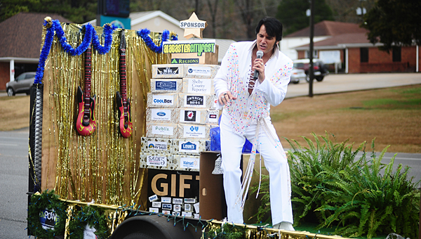 Terry Padgett impersonates Elvis on the Alabaster Arts Council's float in the 2014 Christmas parade. The float was named the parade's most entertaining. (Reporter Photo/Jon Goering)
