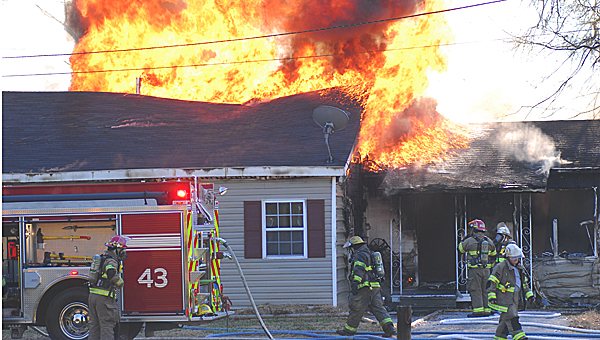 Columbiana and Wilsonville firefighters battle a blaze on Hughes Street in Columbiana on Dec. 11. (Reporter Photo/Neal Wagner)