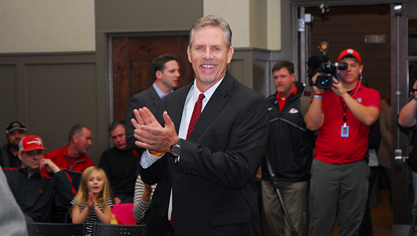 New Thompson High School head football coach and system athletic director Mark Freeman applauds as he enters the room during a Dec. 12 special-called Alabaster School Board meeting. (Reporter Photo/Neal Wagner)