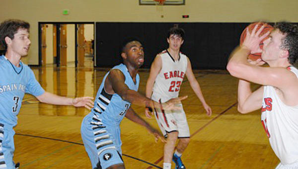 Oak Mountain's Gabe Haynes drives into traffic against three Spain Park defenders during Tuesday night's game. (Contributed/Baker Ellis)
