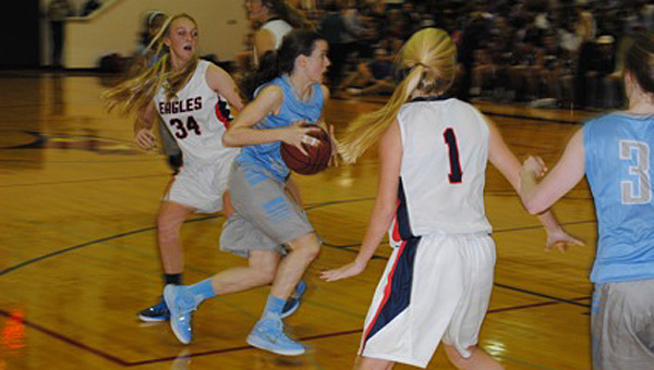Spain Park's Claire Holt drives by Carmen Greenwood of Oak Mountain. (Contributed/Baker Ellis)