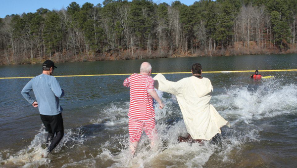 Polar Plunge participants run into the freezing water at Oak Mountain State Park's Double Oak Lake during last year's event. (Contributed)