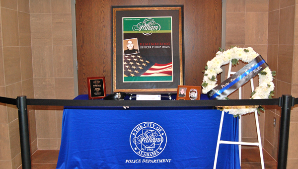 A memorial for Pelham police officer Philip Davis was set up in the lobby of the Police and Courts building on Dec. 3. Davis was killed in the line of duty five years ago on Dec. 3, 2009. (Reporter Photo / Molly Davidson)