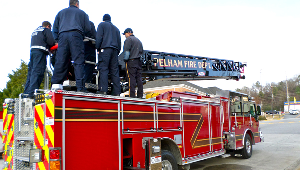 Pelham firefighters learn about ladder operations on the department's new quint truck during a Dec. 17 training session. (Reporter Photo / Molly Davidson)