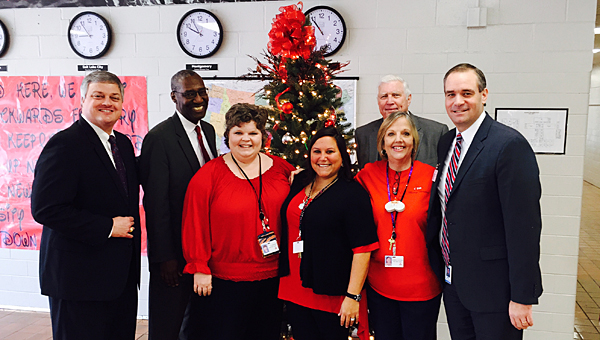 Alabaster School Superintendent Dr. Wayne Vickers, left, joins School Board members in delivering extraordinary compensation checks to teachers at Thompson Intermediate School on Dec. 15. (Contributed)