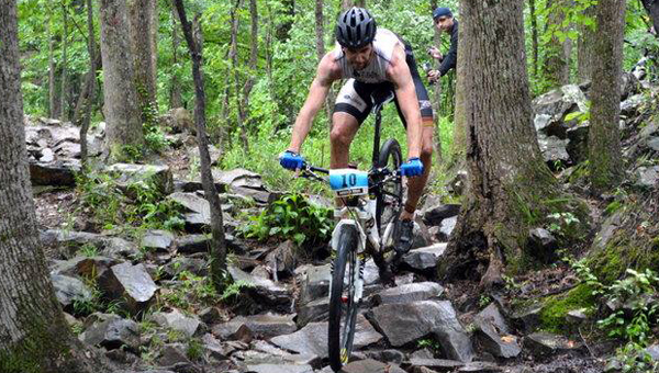 A competitor mountain bikes during last year's XTERRA Southeast Championships at Oak Mountain State Park. (Contributed)