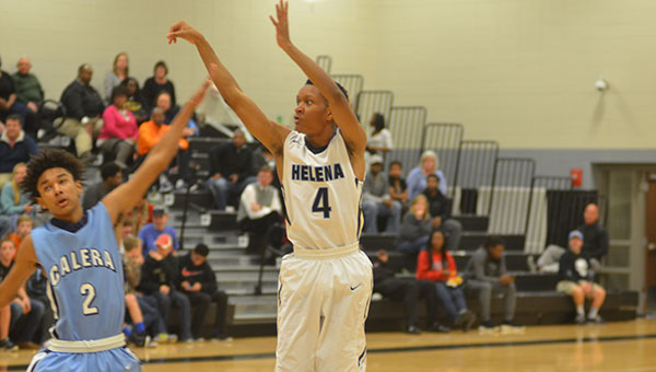 Helena's Jaylen Harris (4) shoots over Calera's Keddrick Thomas (2). Helena defeated Calera 52-24 on Friday, Jan. 9. (Reporter Photo/Graham Brooks)