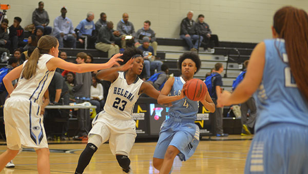 Tyesha Haynes (4) of Calera prepares to pass the ball. Haynes finished with 28 points in the game to lead all scorers. The Lady Eagles defeated Helena 65-57 on Friday, Jan. 9. (Reporter Photo/Graham Brooks)