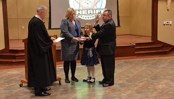 With family by his side, John Samaniego is sworn in as Shelby County's 53rd Sheriff by Circuit Judge Dan Reeves on Saturday, Jan 10. (Reporter Photo/Graham Brooks)