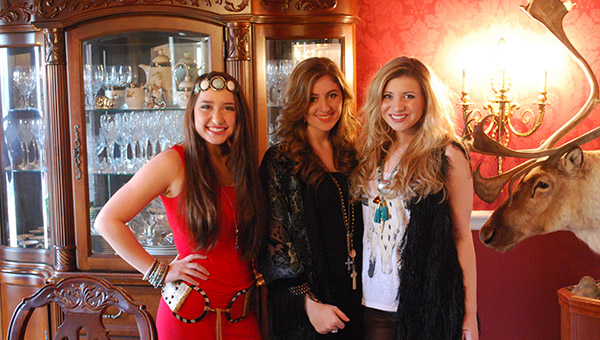 From left, Savannah Coker, Kate Falcon and Victoria Camp have been singing and performing together since May 2013. Their band, Sweet Tea Trio is looking to do big things in 2015. (Reporter Photo/Graham Brooks)