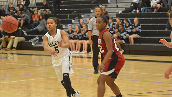 Helena's Morgan Watkins (5) passes the ball off to a teammate. Helena defeated Shelby County 49-29 on Tuesday, Jan. 13. (Reporter Photo/Graham Brooks)