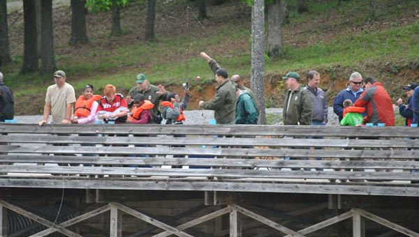 Children and volunteers are seen here enjoying Oak Mountain State Park's Gone Fishin' Not Just Wishin' event last year. The event, which has continued to grow over the past 20 years, will be held from May 13-15 in 2015. (Contributed)