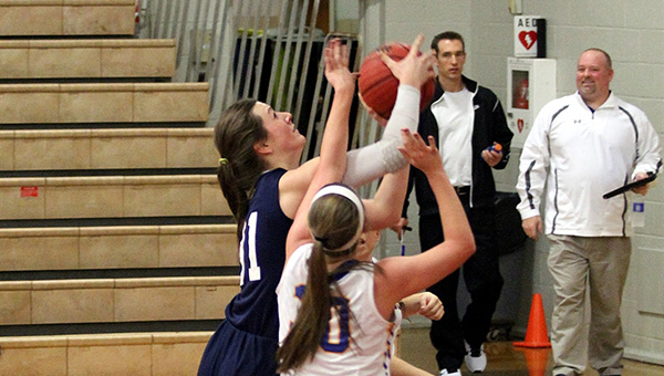 Madison Pierce attempts a shot in the first quarter against Cold Springs where she made a lay up and free throw to surpass 1,000 points in her Oak Mountain Lady Eagles basketball career. (Contributed)