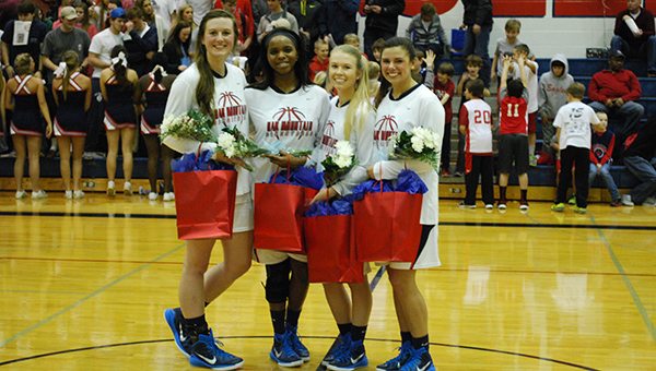 Seniors from the Oak Mountain Lady Eagles are honored after defeating Helena 64-19. (Reporter Photo/Graham Brooks)