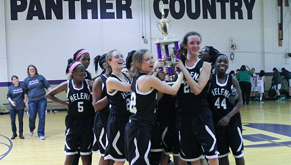 The Helena Middle School girls basketball team are awarded their trophy after defeating John Carroll 42-27 to win the Southern Conference Tournament Championship. (Contributed)