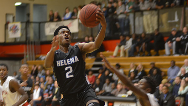 Paul Brown (2) of Helena goes up for a lay up. Brown had 13 points in the game. (Reporter Photo/Graham Brooks)