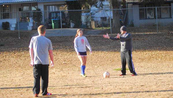 Chris Galloway (in hat) directs players where to go during a drill on Jan. 26. Montevallo is beginning its second season with a soccer program. (Reporter Photo / Baker Ellis)