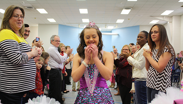 One of the SPIRIT Pageant contestants is excited after receiving one of her gifts. (Contributed)