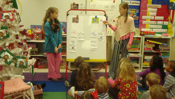 Fifth graders Barbie Allen and Brooke Stroup teach a kindergarten class about the Blue Jay. (Contributed)