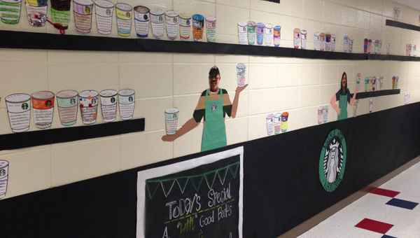 This month, the hallway of Inverness Elementary School features coffee cups decorated by each student. (Contributed)