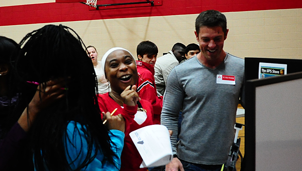 """THS freshman Toni Williams, center, celebrates with her friend Torianna Mitchell, left, and Noah Galloway, right, at the """"Keeping it Real"""" program at the school on Jan. 15. (Reporter Photo/Neal Wagner)"""