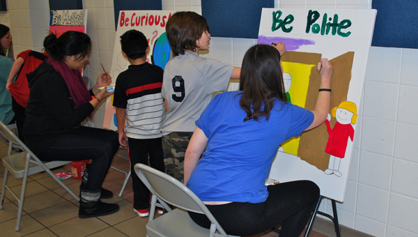 OMHS and OMES students work together to create artwork for the main hallway at the elementary school. (Reporter Photo / Molly Davidson)