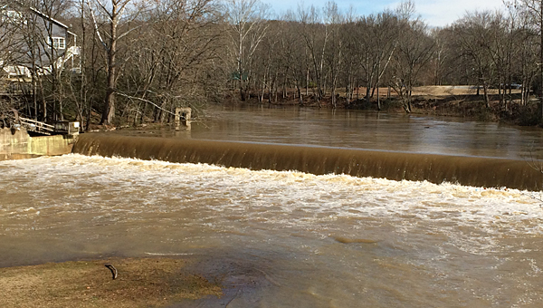 Heavy rainfalls during the first weekend of 2015 caused waters to rise significantly on Buck Creek in Helena. (Reporter Photo/Daniel Holmes)