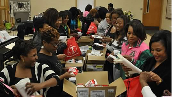 Members of the Psi Xi Omega chapter of Alpha Kappa Alpha Sorority, Inc. work to make safety kits for THS in November. (Contributed)