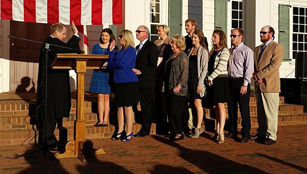 State Rep. April Weaver, third from left, takes her oath of office at American Village in 2014. Weaver and four of her Shelby County colleagues are chairing committees in the Alabama Legislature this year. (Contributed)