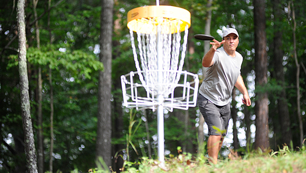 A disc golfer takes a shot at the basket at the Inverness disc golf course of U.S. 280. Alabaster is working to install a disc golf course at Veterans Park off Alabama 119 (File)
