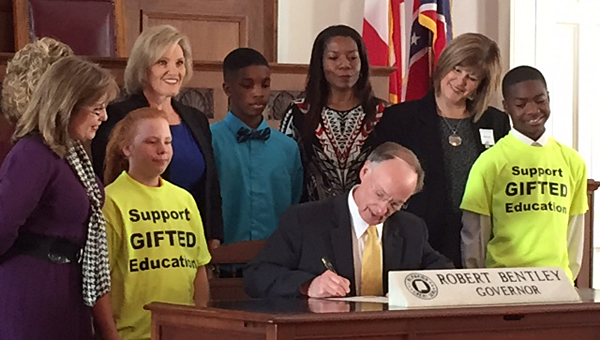 Thompson Intermediate School gifted education teacher Rita Sparks, third from left, joins students and teachers from across the state during a recent meeting with Alabama Gov. Robert Bentley, seated. (Contributed)