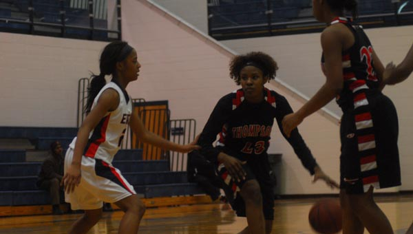 Janese Richardson of Thompson looks for a way around Kennedy Smith of Oak Mountain in Thompson's 56-31 victory. (Reporter Photo / Baker Ellis)