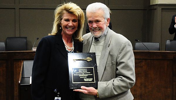 Alabaster Mayor Marty Handlon, left, presents a key to the city to longtime Alabaster business owner Bob Green during a Jan. 26 City Council meeting. (Reporter Photo/Neal Wagner)