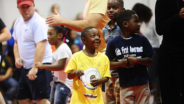 Members of Alabaster's Kids First Awareness Community Center dance during a Jan. 19 Martin Luther King Jr. Day celebration at the Shelby County Instructional Services Center. (Reporter Photo/Neal Wagner)