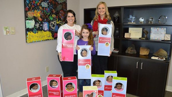 Nancy Kay Sharman, center, joins Kellie Reece, left, and Madison Kaitlyn Monday, right, with the Camp Smile-A-Mile Hospital Outreach Program. (Contributed)