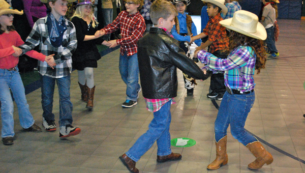 OMES second grade students perform a square dance for their parents and family members during physical education on Jan. 22. (Reporter Photo / Molly Davidson)
