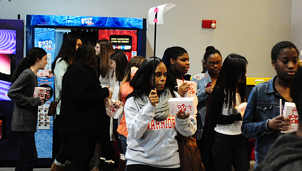 Thompson Middle School eighth-grade teacher Fallon Brantley, center, leads her class into Alabaster's AmStar movie theater during the school's anti-bullying day on Jan. 16. (Reporter Photo/Neal Wagner)