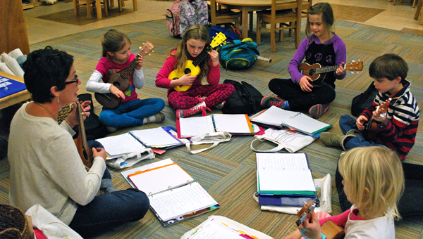 "Students in Hilltop Montessori School's Ukulele Jam Club work on friendship songs, such as ""Mail Myself to You"" by Woody Guthrie. (Reporter Photo / Molly Davidson)"