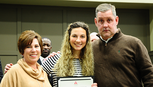 Laura Morris, left, and her husband, Joseph, join their host exchange student Alice Zanotti at a Jan. 14 Alabaster Board of Education meeting. (Reporter Photo/Neal Wagner)