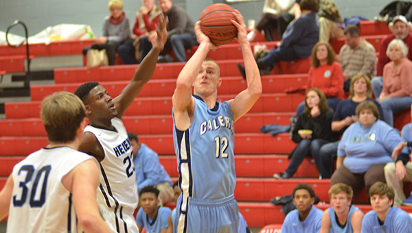 Drew Marling (12) of Calera attempts a shot in an area tournament game against Helena. Helena won 48-47 to advance to the finals on Thursday, Feb. 5. (Reporter Photo/Graham Brooks)