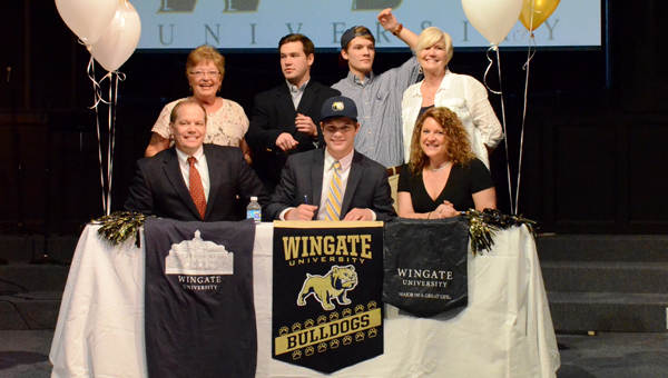 Kingwood Christian School senior Gage Summerall signs his letter of intent to play football for Wingate University on Feb. 4. (Contributed / Dianne Cunningham)