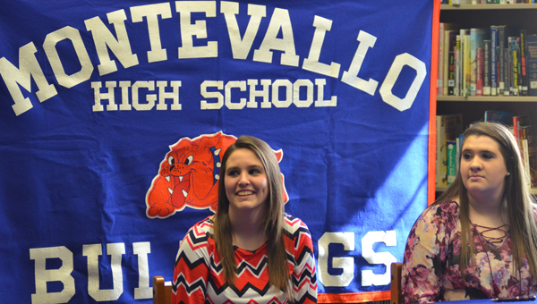 Isabella Howell (left) and Kaylee Smith prepare to sign their letters of intent to play volleyball at Wallace Community College in Selma. (Reporter Photo / Baker Ellis)
