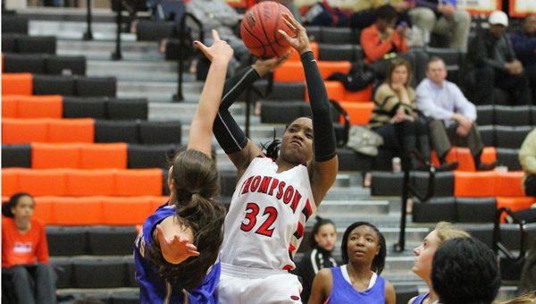 Kelsea Bivins goes up for a basket in Thompson's Feb. 4 opening round area tournament win against Tuscaloosa County. (Contributed / Eric Starling)