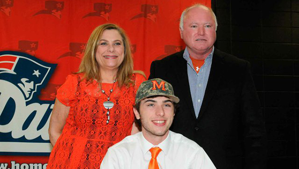 Homewood High School senior Brett White signs a baseball scholarship to Marion Military Institute. His father Brian White, is a Shelby County Sheriff's Office Deputy. (Contributed)