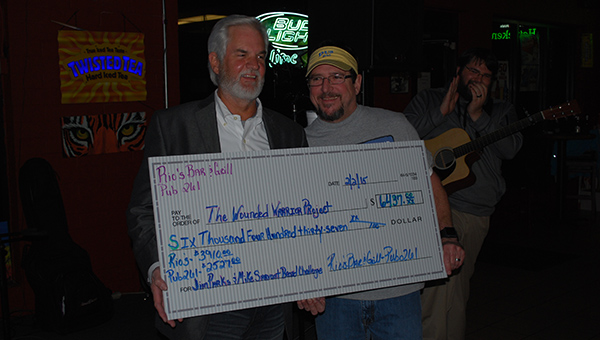 Jim Parks and Mike Sarvaunt collectively raised $6,437 for the Wounded Warriors Project after competing in a beard growing challenge. (Reporter Photo/Graham Brooks)