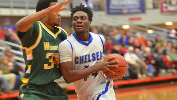 Darrell Foster of Chelsea drives the lane during their 6A Sweet Sixteen loss to Woodlawn on Feb. 13. (Reporter Photo / Baker Ellis)