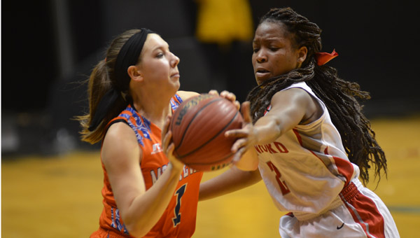 Emri Hannon of Montevallo has her pass denied by Munford's Kedra Curtis during the Lady Bulldogs 49-53 loss at Alabama State on Feb. 16. (Reporter Photo / Baker Ellis)