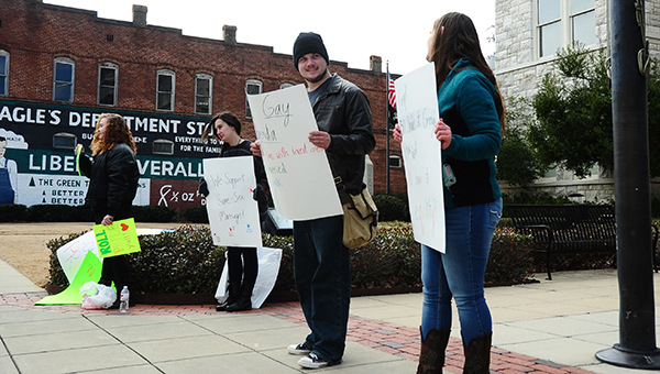 UM students Rachel Thornton, Amalia Kortright, Mason Shell and Bethany Hunt gathered outside of the Shelby County Courthouse on Tuesday, Feb. 17 to show their support for same-sex marriage. (Reporter Photo/Neal Wagner)